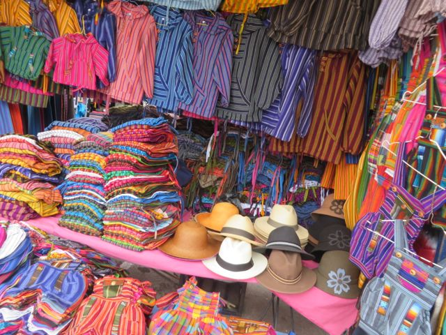 Lots of amazing color at the  Otavalo market. I was taking photos as discreetly as possible, as I wasn't interested in buying anything - just people-watching - so I didn't want to get any hopes up among the vendors.