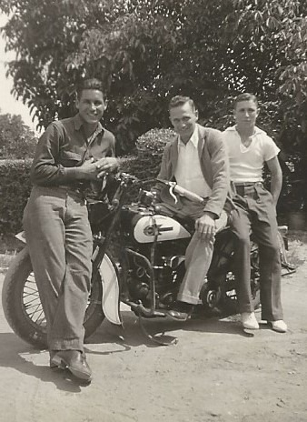 My Grandpa Gus - looking cool on a motorcycle, sometime c. 1940.