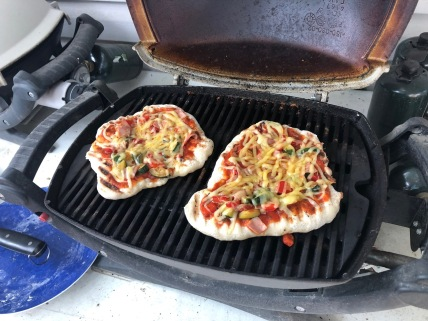 Experimenting with grilled pizza.